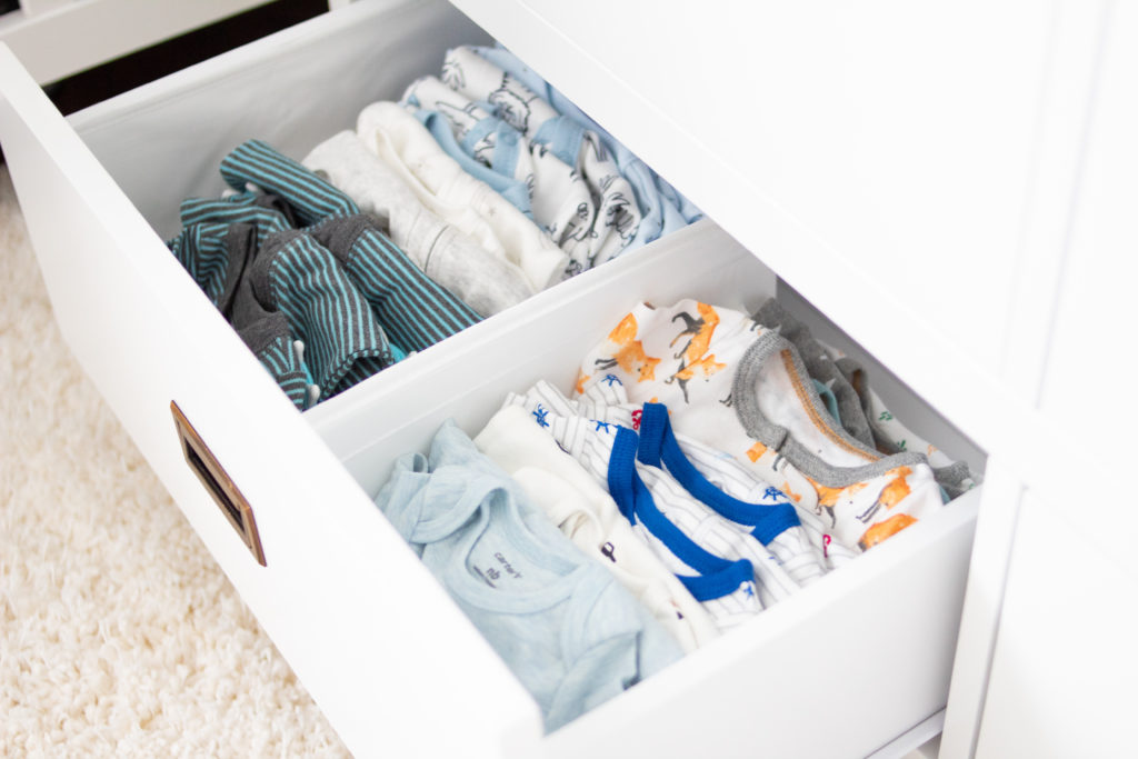 Organizing a dresser for twins took some extra planning and creativity. Check out my tips to organize a dresser for twins. #twinprengnay #twinmom #twins #twinboys #nursery #nurseryfurniture #babyboys #nesting #organization #babies