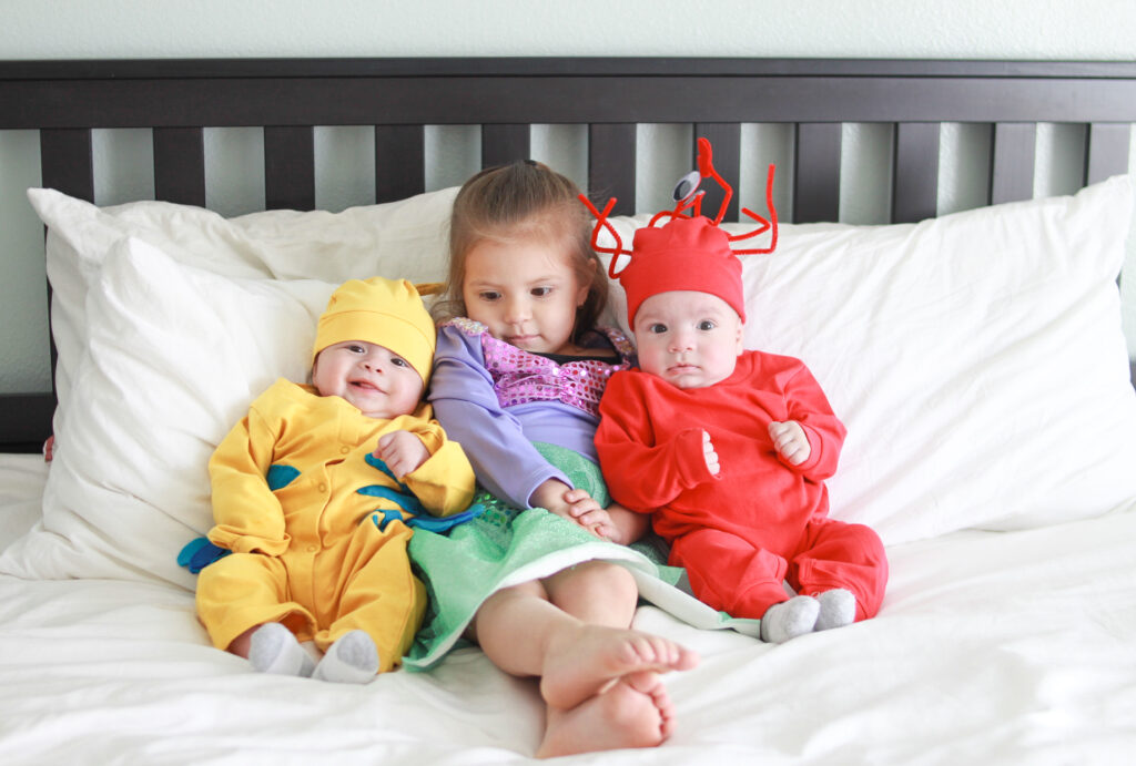 This 15 Minute No Sew Sebastian costume for baby is perfect for Halloween, birthday party, or Disney trip. It is both comfortable and super easy to make. #disney #disneystyle #disneyhalloween #disneytrips #disneyday #disneyoutfit #thelittlemermaid #sebastian #costumes #diy #disneydiy #diycostume #diykids #nosew #underthesea #princessariel