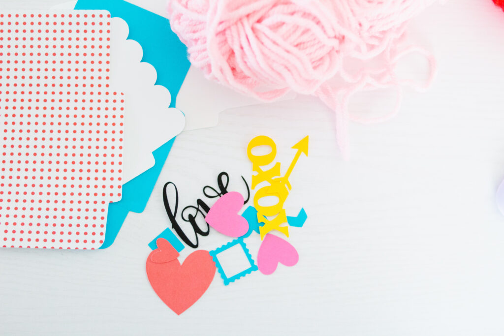 DIY Valentine's Day Envelope & Pom Pom Garland for your home! Super easy and made with materials I already had! #ValentinesDay #cricutcreated #CricutCrafts #Crafting #crafts #crafter #decor #diydecor #decorations #vday