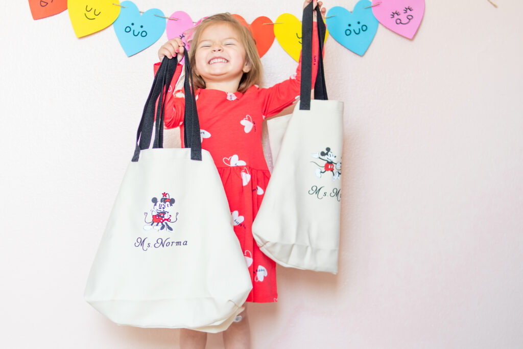 These DIY Disney totes are perfect for anyone and everyone in your lives! We personalized them for a great Valentines teacher gift with my Cricut EasyPress2 ! #CricutCreated