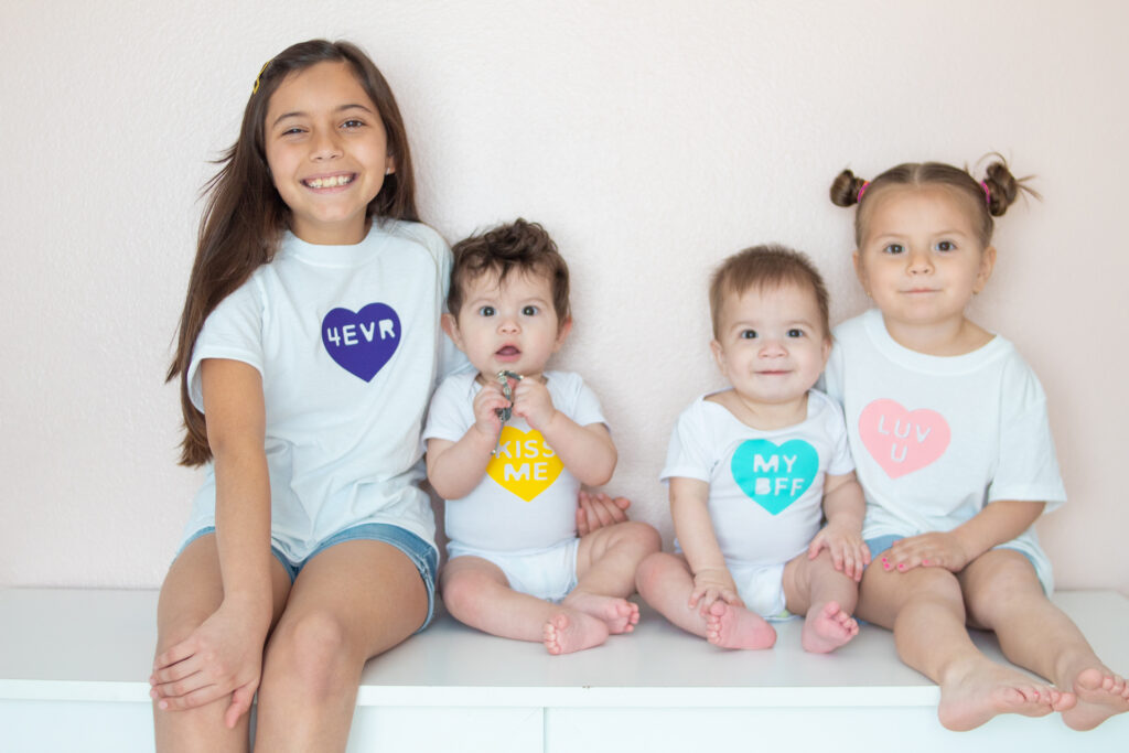 These DIY Conversation Hearts Shirts are perfect for Valentine's Day! You can create them for your whole family in under 30 mins! #DIY #CricutCreated #cricut #cricutcrafts #crafting #cricutshirts #diycricut #diyclothes #diyshirts #diyvalentines #valentinesday #valentinescrafts #valentinesoutfit