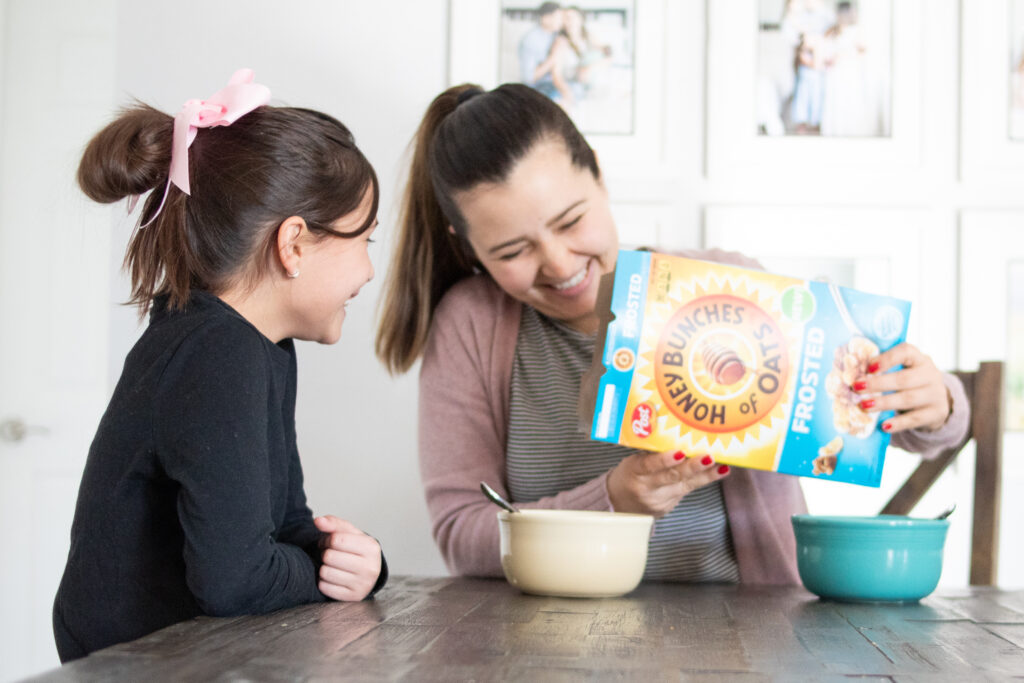 Women pouring cereal bowl