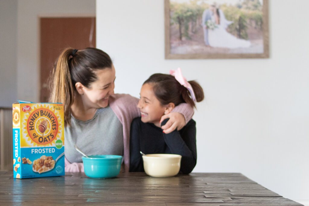 mother daughter with cereal