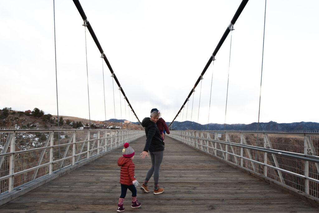 mom with kids on bridge