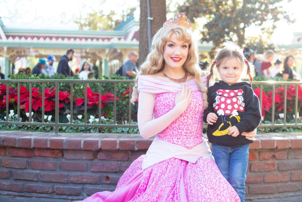 girl with princess at disneyland