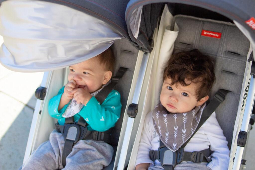 babies in double stroller social distancing walks