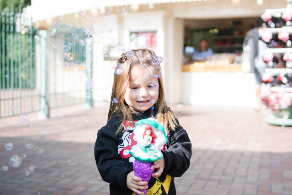 girl with bubble wand at disneyland