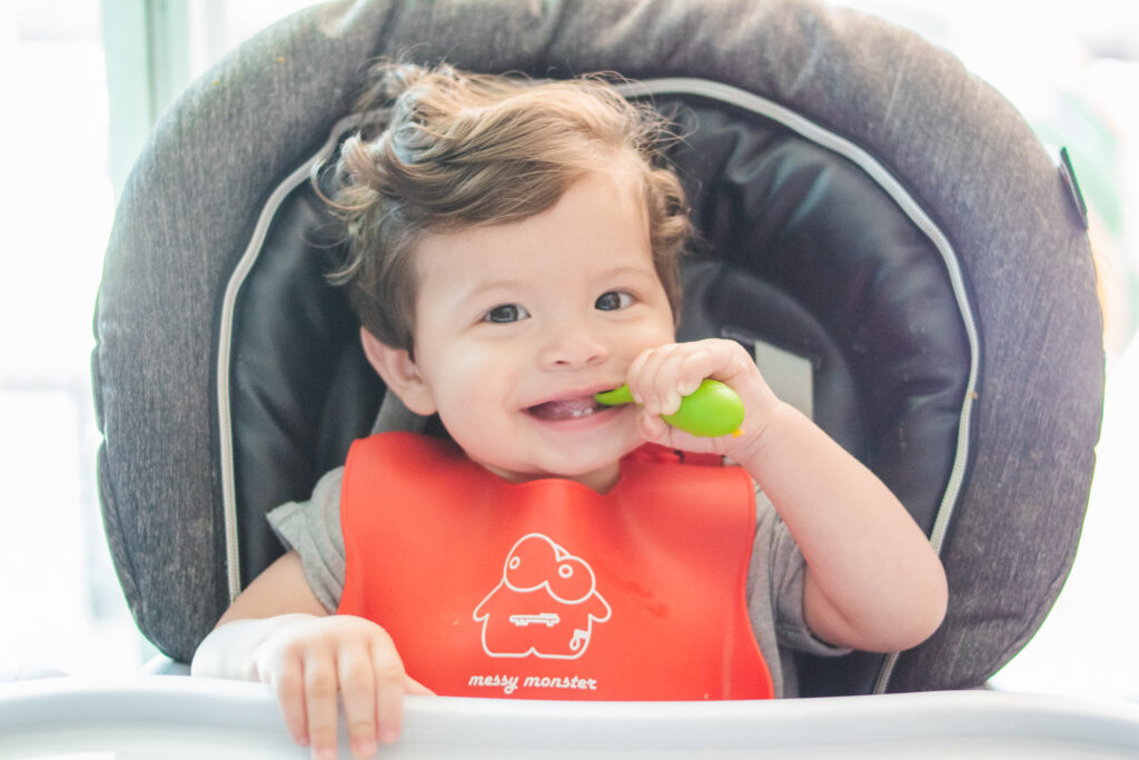 baby with baby led weaning spoon