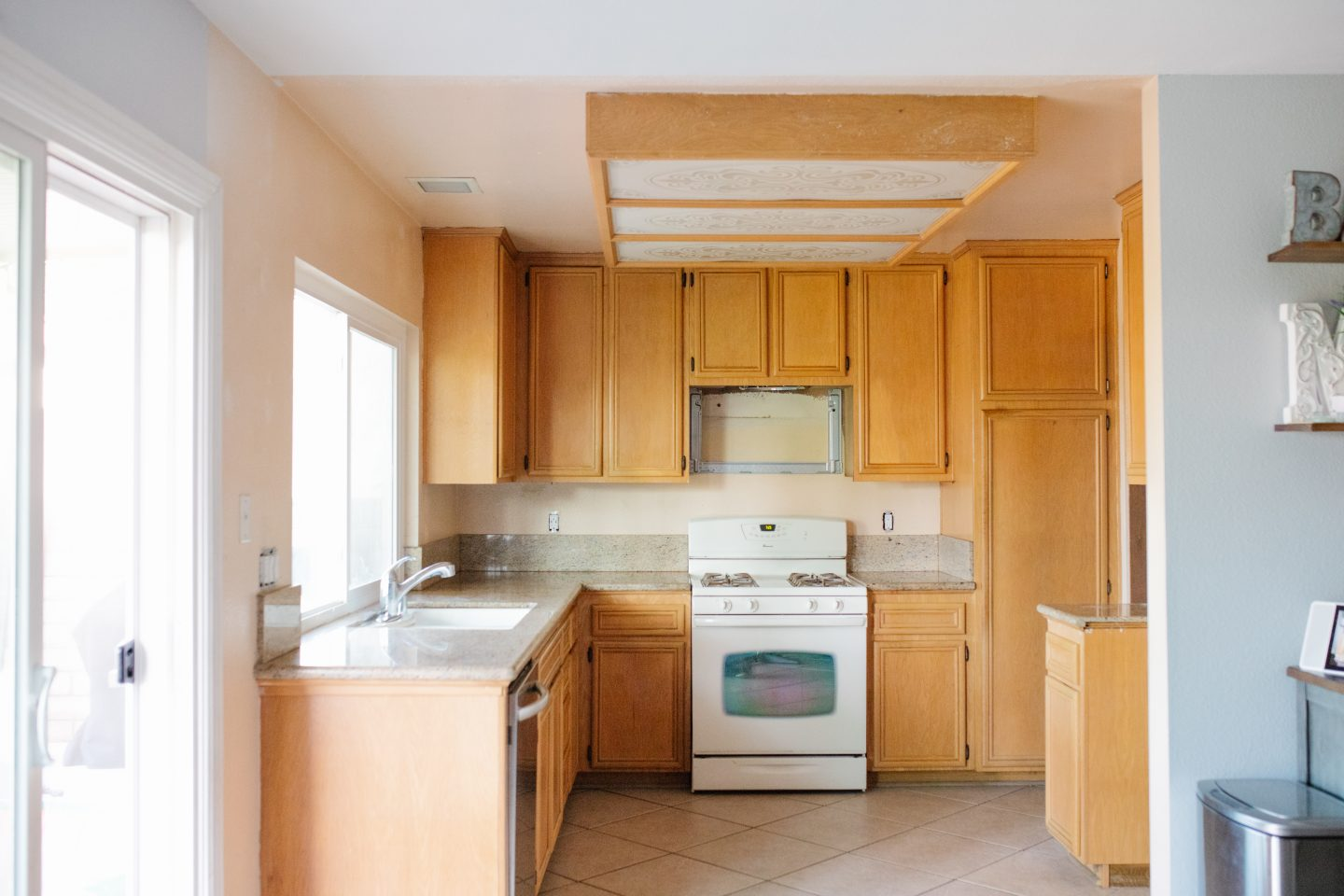Before picture of how to paint kitchen cabinets
