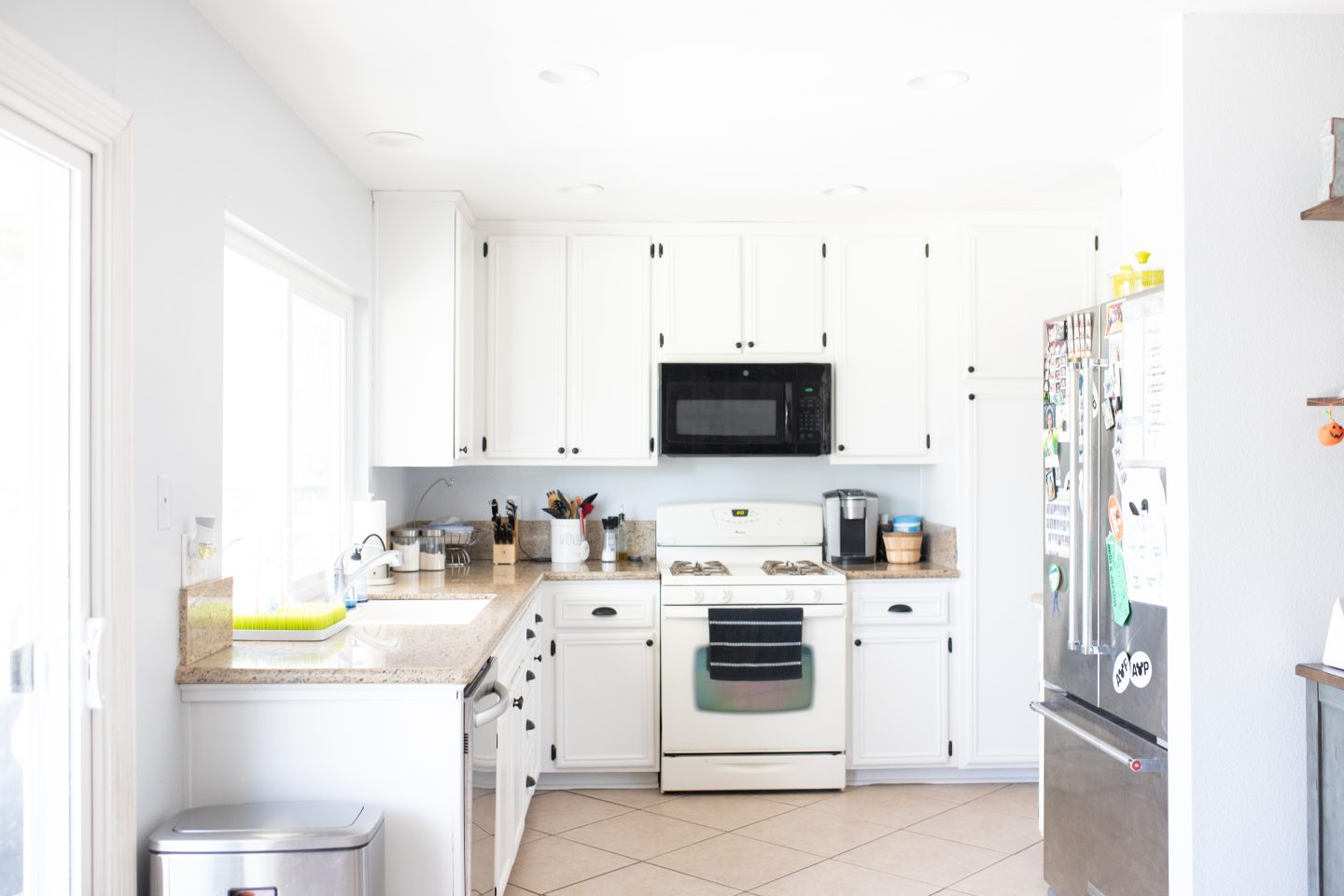 In only 2 days our kitchen cabinets were painted and updated! Sharing how to paint kitchen cabinets in only two days and under $500 ! Painting kitchen cabinets is a great way to give your kitchen an update! #diy #diyblog #tutorial #kitchencabinets #kitchens #kitchen #farmhousekitchen #kitchenupdate #updatekitchen #diykitchen